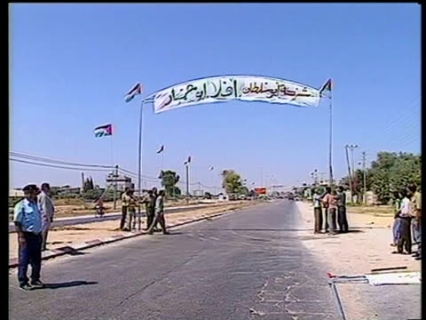 banners and flags put in place for yasser arafat's homecoming gaza july 1994 - gaza strip stock videos & royalty-free footage