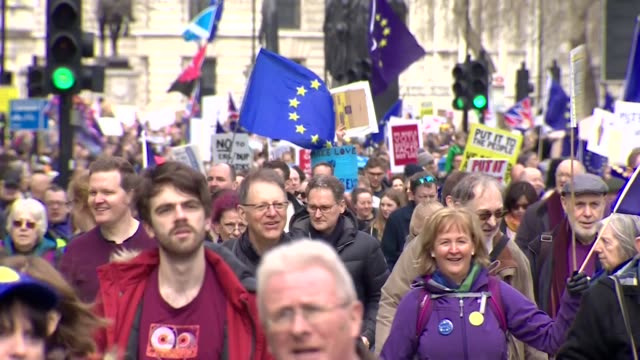 banners and placards being held aloft at put it to the people anti brexit people's vote protest march - european union stock videos & royalty-free footage