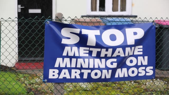 banners protesting at a site on chat moss in manchester that has been given planning permission for fracking and coal bed methane mining manchester uk - moss stock videos & royalty-free footage