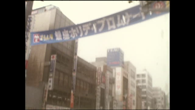 Banners stretch across Ginza Street as pedestrians gather on the first day of the Pedestrian Paradise.