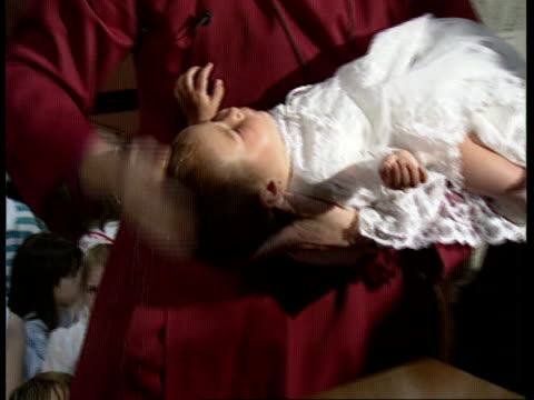 should the church of england make it harder itn england kent rochester cms rt rev colin buchanan holding baby rachel and performing baptism tilt down... - キリスト教点の映像素材/bロール