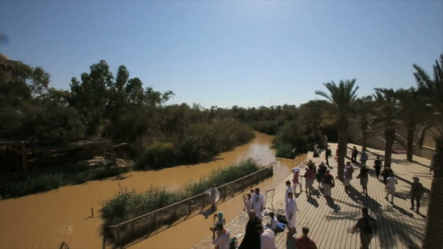 baptismal ceremony at qasr el yahud baptism site in the jordan river valley, israel - バプテスト点の映像素材/bロール