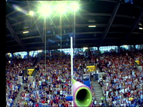 Bar cam Yelena Isinbayeva clearing bar at 490m for World Record crowd rise to their feet and applaud in wild abandon 2004 Crystal Palace Athletics...