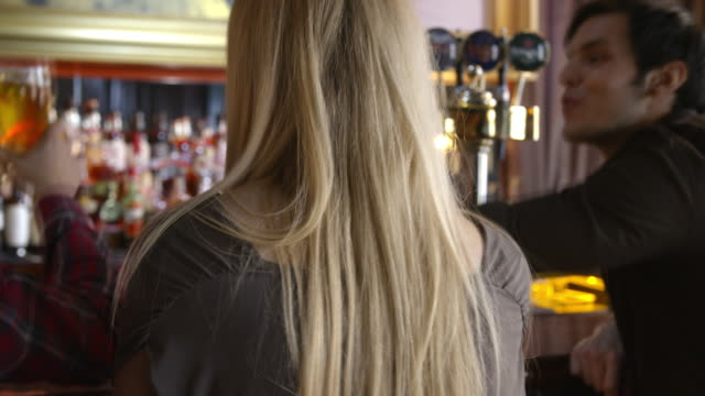 bar counter with group of people from behind - dublin ireland stock videos and b-roll footage