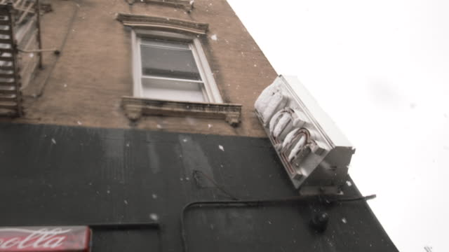 bar exterior shot during a snow storm - nightlife stock videos & royalty-free footage