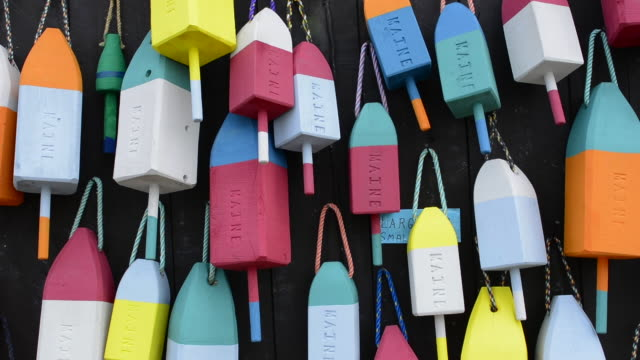 bar harbor maine colorful buoys on wall for sale and state specialty souvenirs for lobster traps catching fishing - buoy stock videos and b-roll footage