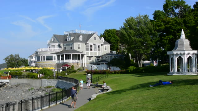 bar harbor maine famous exclusive and expensive bar harbor inn with buildings and tourists in summer with gazebo - inn stock videos & royalty-free footage