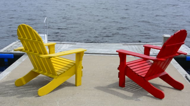 bar harbor maine life in maine peaceful scene on water with adirondack chairs to relax - アディロンダックチェア点の映像素材/bロール