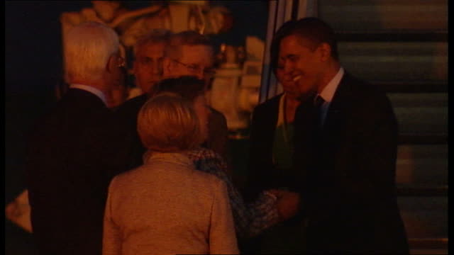 barack obama arriving at stanstead airport ahead of g20 summit night us president barack obama and wife michelle obama disembarking plane and meeting... - tarmac stock videos & royalty-free footage