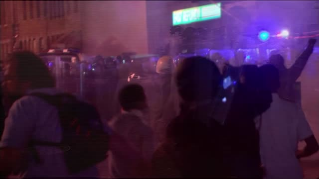 barack obama calls on police forces to heal rift with communities they serve; t29041537 maryland: baltimore: at night line of riot police officers... - tear gas stock videos & royalty-free footage