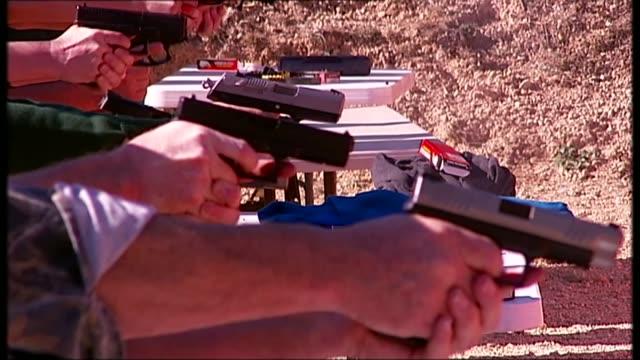 barack obama gun curbs plan challenged by gun lobby t11021309 / 1122013 ext various of people firing handguns at open air gun range - rinnsteinkante stock-videos und b-roll-filmmaterial