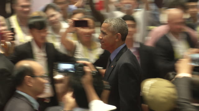 barack obama president of the usa walks to a meeting during the association of southeast asian nations summit the laotian capital vientiane - association of southeast asian nations stock videos & royalty-free footage