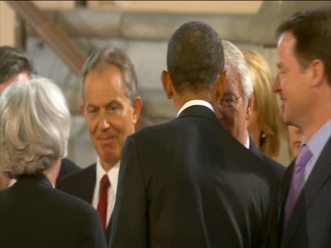 Barack Obama shakes hands with David Cameron Nick Clegg and former prime ministers as he leaves Westminster Hall