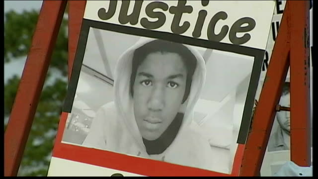 Barack Obama steps into growing row over shooting of black teenager Trayvon Martin USA Florida Orlando EXT Silhouette of protesters marching feet of...