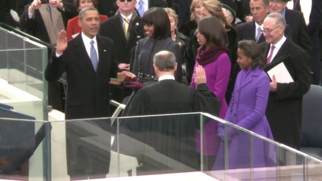 vídeos de stock, filmes e b-roll de barack obama vowed to pursue the us quest enshrined in the constitution for equality among all americans monday in his inaugural speech highlighting... - tomada de posse