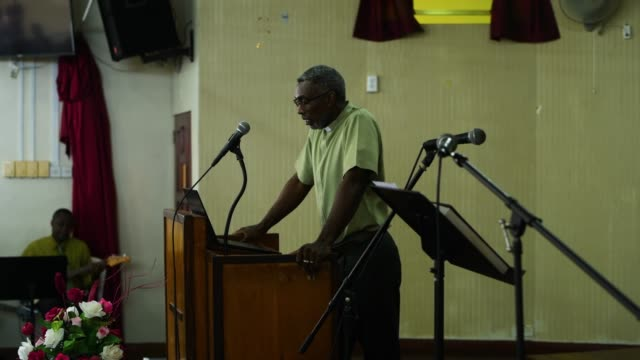 barbados gospel church service with a preacher speaking to the congregation at speightstown - congregation stock videos & royalty-free footage