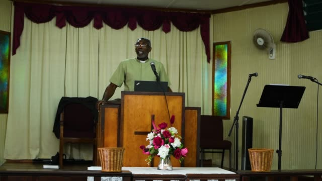 barbados gospel church service with a preacher speaking to the congregation at speightstown - preacher stock videos & royalty-free footage