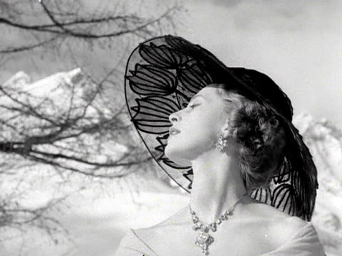 Barbara Muvia models a black lace hat during an open air fashion show in St Mortiz