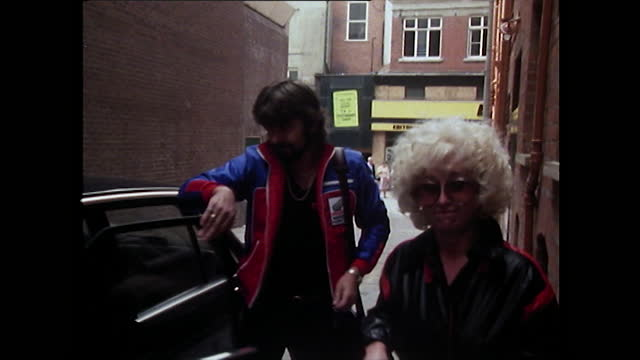barbara windsor arrives at the stage door of a theatre driven by her manager who helps her out of the car after newspapers had published stories of... - alley stock videos & royalty-free footage