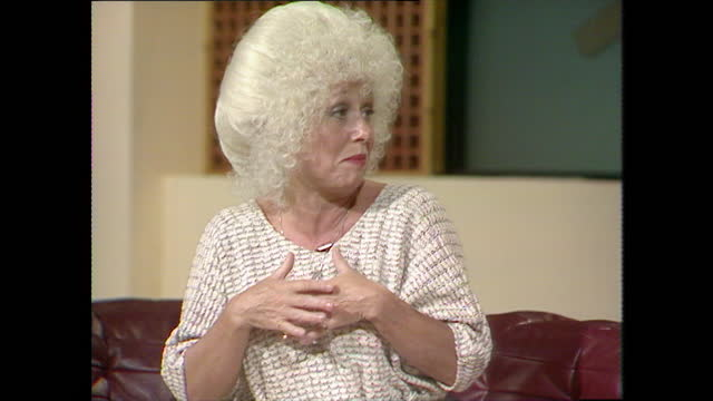 barbara windsor doesn't understand the fascination with her famous bosom; 1983. - transparent stock videos & royalty-free footage
