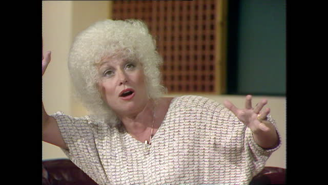 barbara windsor recalls memories of her first acting job as a teenager on 'the belles of st. trinians' and forgetting to cover her cockney accent;... - medium shot stock videos & royalty-free footage