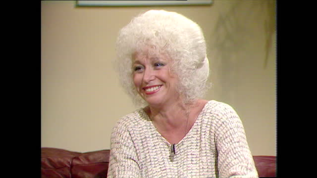 barbara windsor reminisces about joining the carry on films and being nervous and talks affectionately about the cast and crew; 1983. - connection stock videos & royalty-free footage