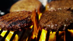 Barbecue grill cooking fresh gourmet ground beef burgers