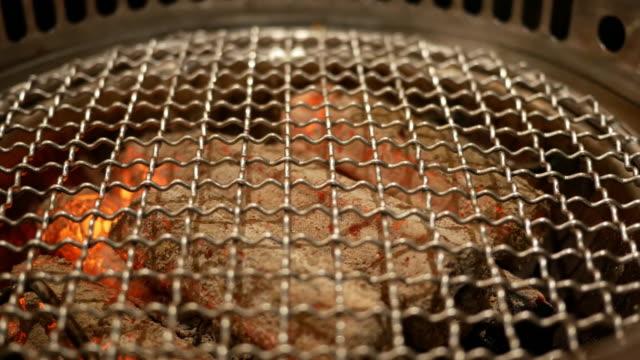 barbecue grill on the table - grigliare video stock e b–roll