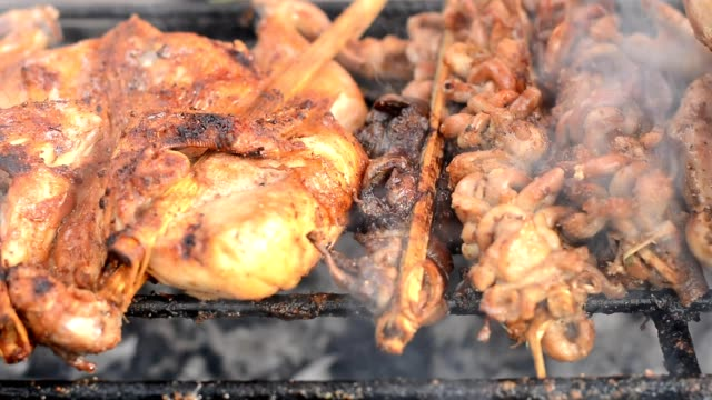 barbecue grilled chicken on grill stove - grilled chicken stock videos and b-roll footage