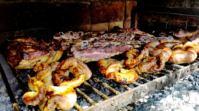 asado argentino a la parrilla - barbecue with smoke