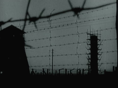 barbed wire fence, guard towers, watchtower at abandoned concentration camp, postwar - concentration camp stock videos & royalty-free footage