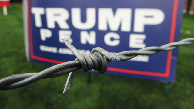 Barbed wire fence in front of Donald Trump poster in Columbus Ohio