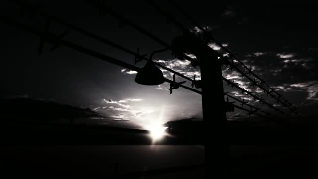 barbed wire fence  of the prison - campo di concentramento video stock e b–roll