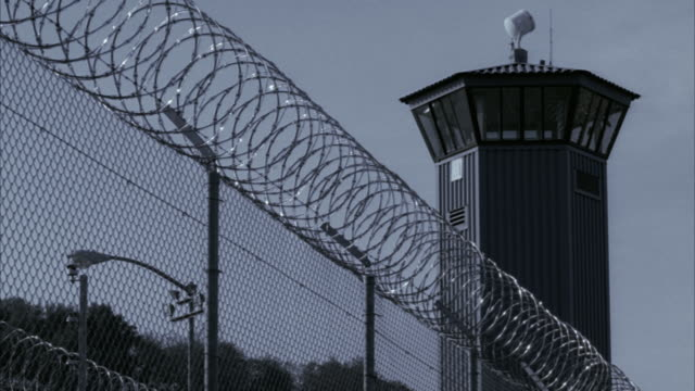 LA MS Barbed wire fence outside guard tower at Sacramento State Prison / Folsom, California, USA