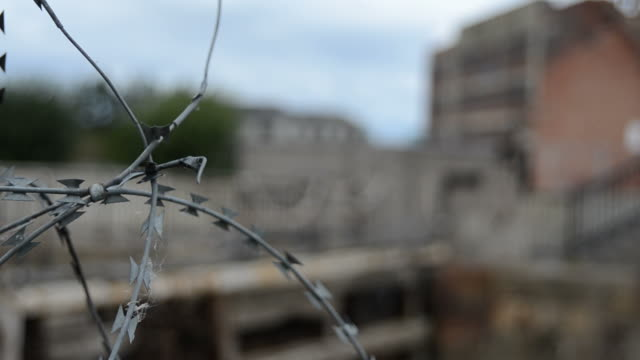 Barbed Wire Fence Surrounding Derelict Building