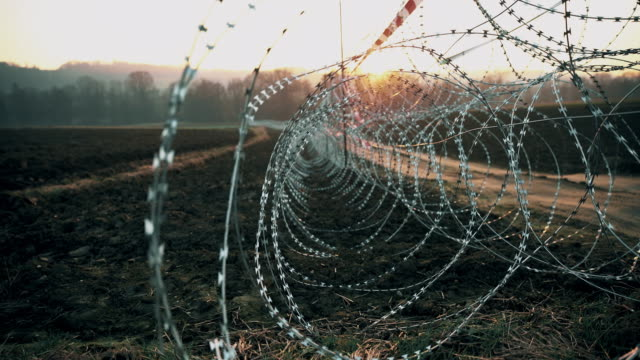 ds barbed wire placed on the field - chainlink fence stock videos and b-roll footage