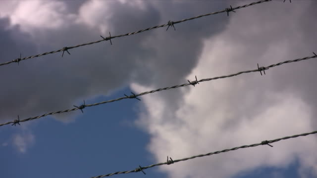 "barbed wire sky ""focus on fence v2"" - separation stock videos & royalty-free footage"