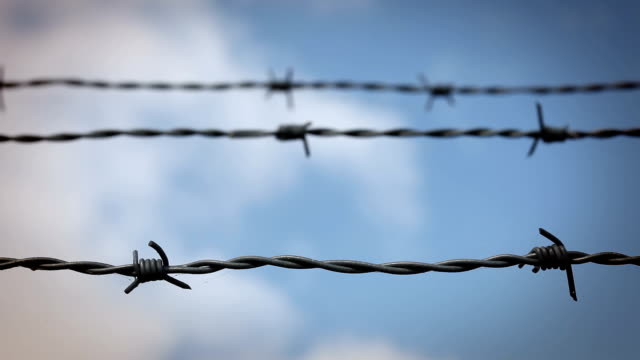 barbed wire - time lapse sky - barbed wire stock videos & royalty-free footage