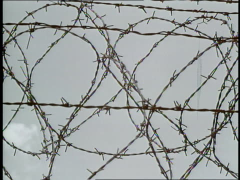 barbed wire tops the berlin wall dividing east and west germany - east stock videos & royalty-free footage