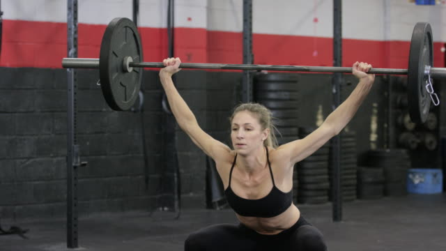 barbell lift - fatcamera stock videos and b-roll footage