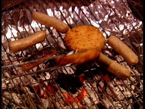 'barbeque brawl' union leader wins unfair dismissal case england ext / night cms flames of charcoal barbecue tms pair of tongues being used to turn... - pair stock videos & royalty-free footage