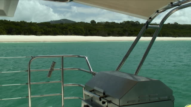 MS Barbeque grill on boat's deck, beach in background, Whitsunday Islands, Queensland, Australia