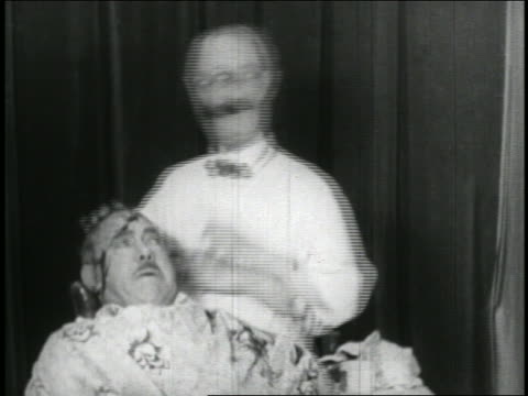 B/W 1928 barber breaking egg on head of man + massaging it into his scalp / 1 egg has chick in it