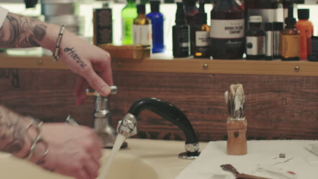 barber cleaning razor - movember stock videos & royalty-free footage