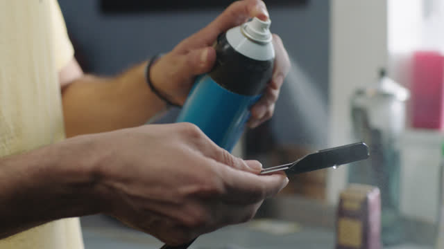 slo mo. a barber cleans his straight edge razor - schere stock-videos und b-roll-filmmaterial