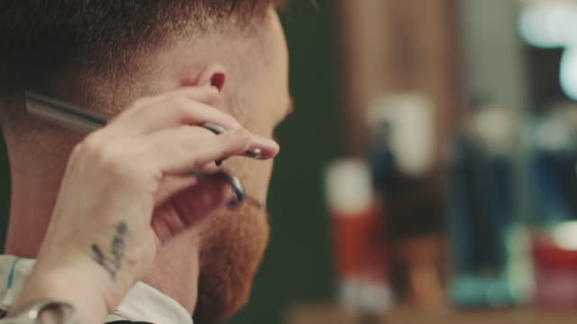 barber cutting a mans hair - movember stock videos & royalty-free footage