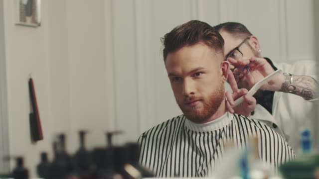 barber cutting a mans hair - barber stock videos & royalty-free footage