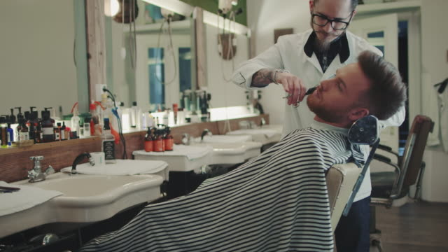 barber cutting beard - barber shop stock videos & royalty-free footage