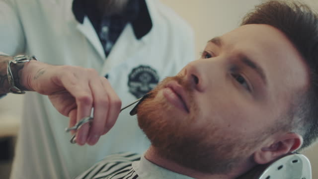 barber cutting beard - movember stock videos & royalty-free footage