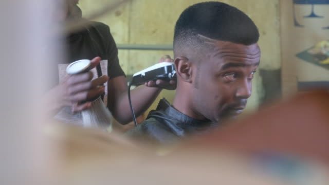 barber cutting his clients hair - barber shop stock videos & royalty-free footage